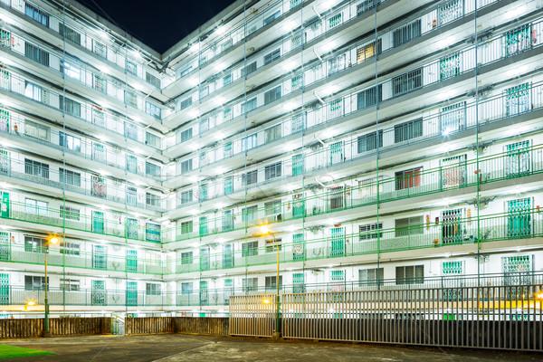 Nyilvános lakásügy Hongkong éjszaka ház épület Stock fotó © leungchopan