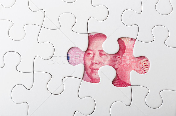 Stock photo: Missing puzzle piece with Chinese yuan