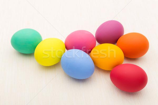Színes húsvéti tojás fehér vászon tavasz étel Stock fotó © leungchopan