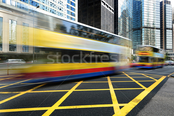 Bus speeding through the street Stock photo © leungchopan