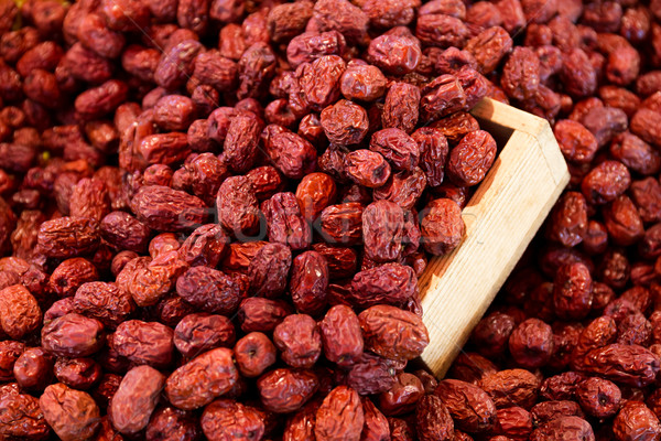 Dried red jujube with wooden container Stock photo © leungchopan