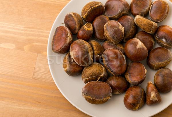 Chestnut on plate Stock photo © leungchopan