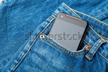 Blue jean pocket with mobile  Stock photo © leungchopan
