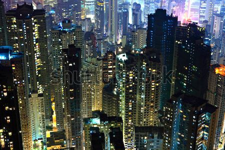 Hong Kong with crowded buildings at night Stock photo © leungchopan