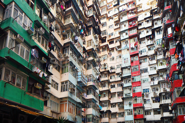 Overpopulated residential building in Hong Kong Stock photo © leungchopan