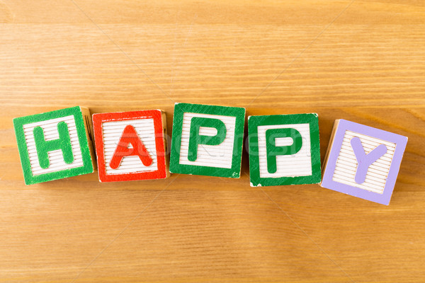 Toy block with spelt in happy  Stock photo © leungchopan