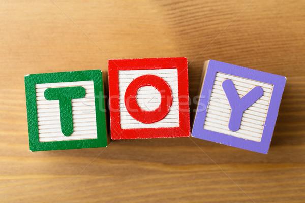 Foto stock: Brinquedo · de · madeira · jogo · madeira · diversão · leitura · jogar