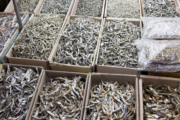 Dried anchovy fish for sell in market Stock photo © leungchopan