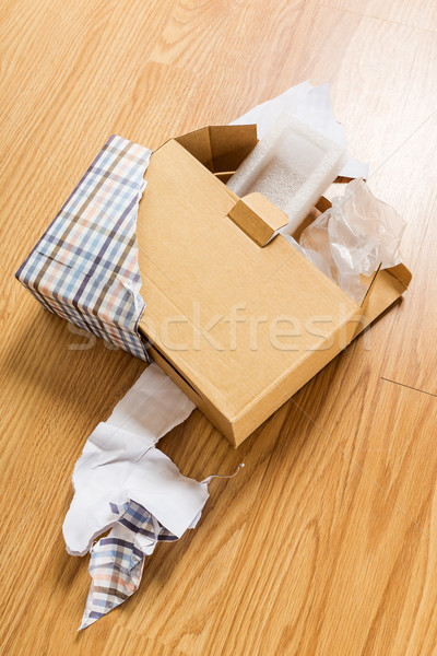 Unwrap of present Stock photo © leungchopan