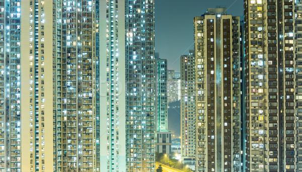 Packed building in Hong Kong at night Stock photo © leungchopan