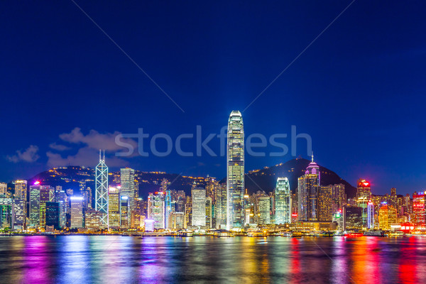 Hong Kong city lit up at night Stock photo © leungchopan