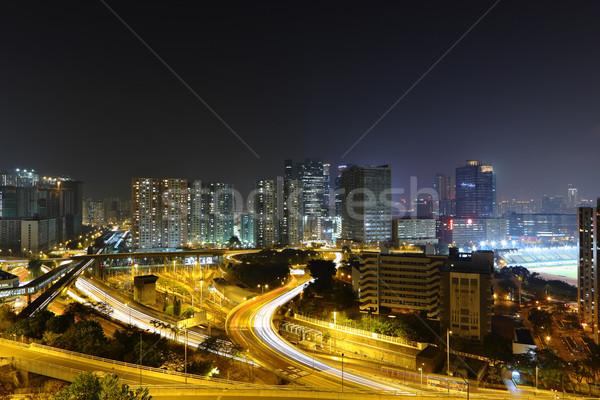 современных ночному городу свет моста синий ночь Сток-фото © leungchopan