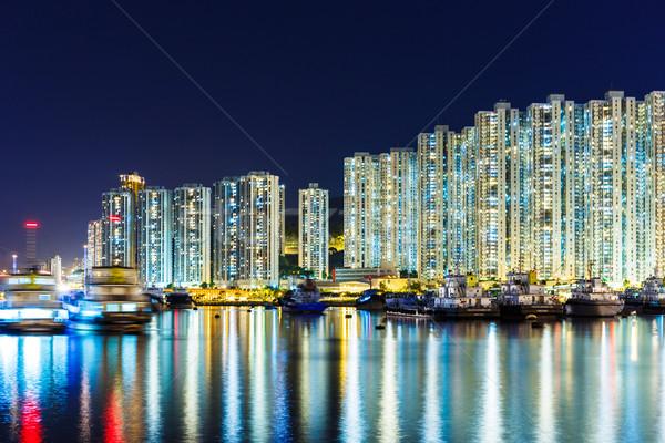 Overpopulated apartment building at night Stock photo © leungchopan