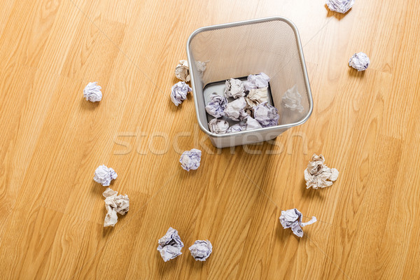 Trash basket and paper ball Stock photo © leungchopan