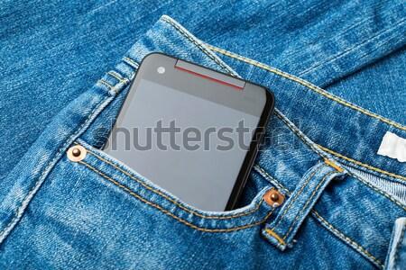 Jean and mobile Stock photo © leungchopan