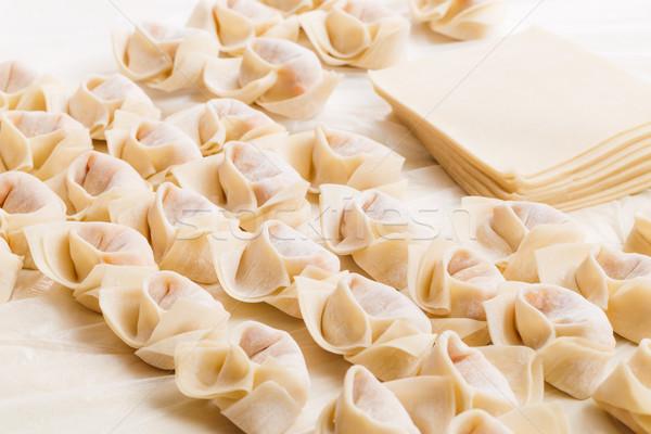 Homemade dumpling and raw material Stock photo © leungchopan