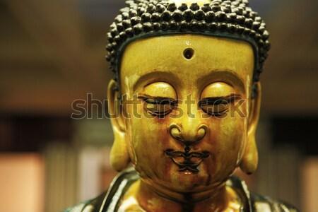 Portrait of a Buddha statue Stock photo © leungchopan
