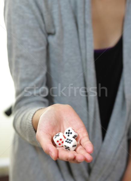 dice on hand Stock photo © leungchopan