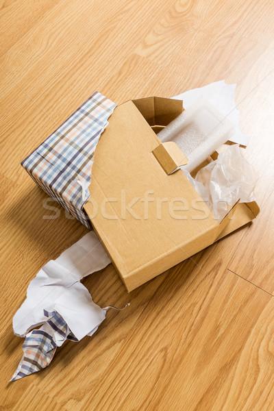 Unwrap of gift  Stock photo © leungchopan
