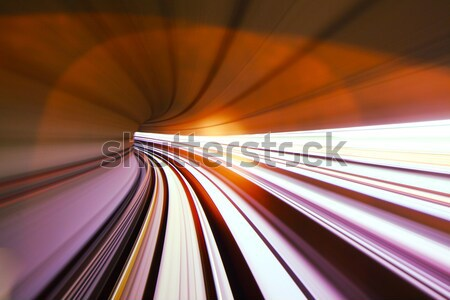 Fast train moving in tunnel Stock photo © leungchopan