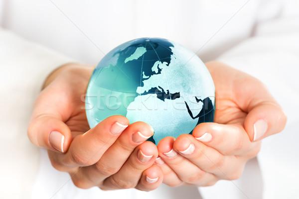 Hand holding blue earth globe Stock photo © leventegyori