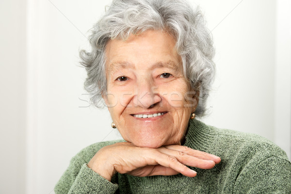 Smiling happy senior lady portrait Stock photo © leventegyori