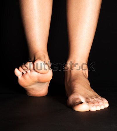 Foot isolated on black Stock photo © leventegyori