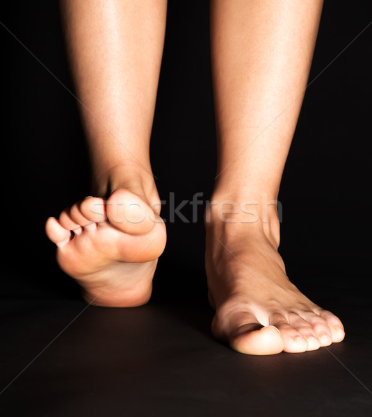 Foot stepping in black Stock photo © leventegyori