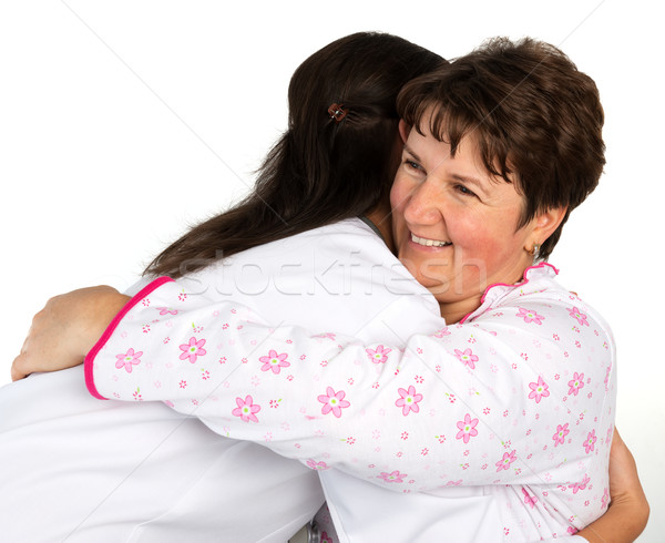 A senior woman and nurse hugging Stock photo © leventegyori