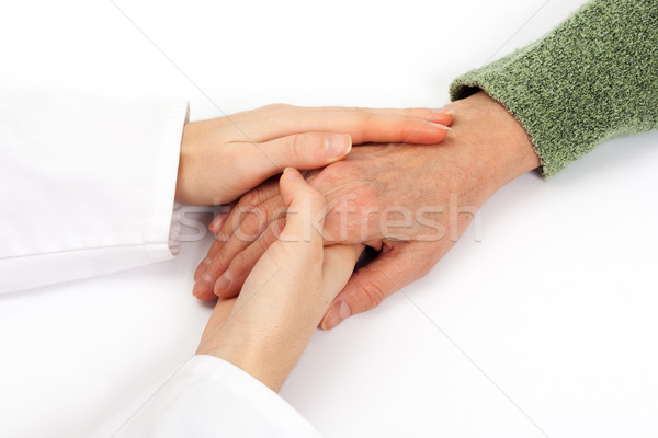 Holding senior hand care Stock photo © leventegyori