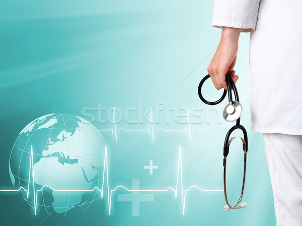 Doctor with medical green background Stock photo © leventegyori