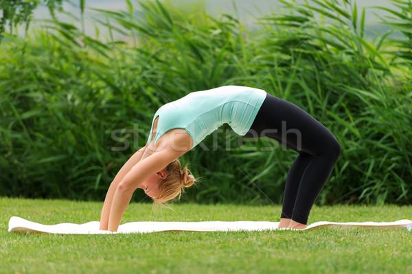 Fiatal nő híd póz jóga test háttér Stock fotó © leventegyori