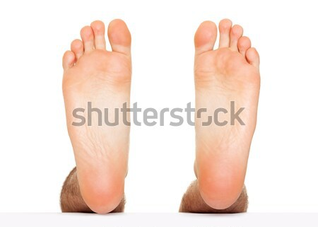 Foot stepping isolated Stock photo © leventegyori
