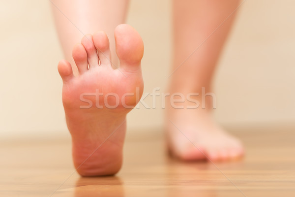 Foot stepping closeup Stock photo © leventegyori