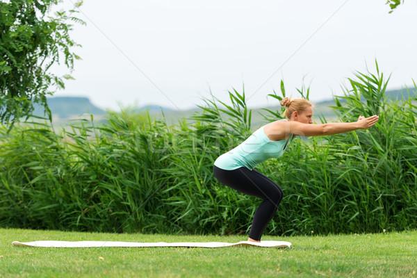 Awkward yoga pose Stock photo © leventegyori