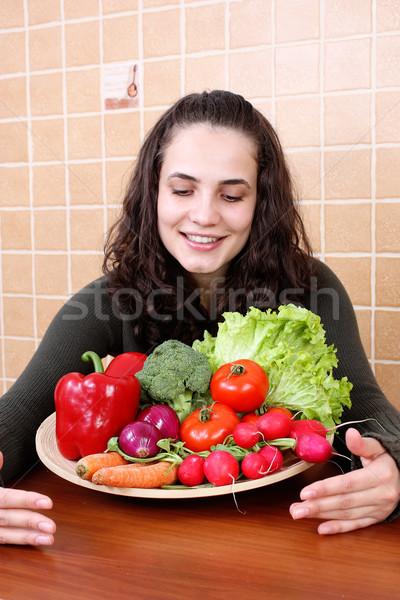Beautiful Young Woman Eating Vegetable Salad Stock photo © leventegyori
