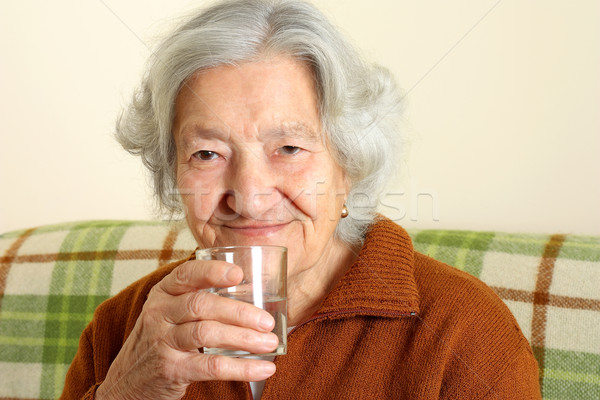Grandmother drinks a glass of fresh water Stock photo © leventegyori