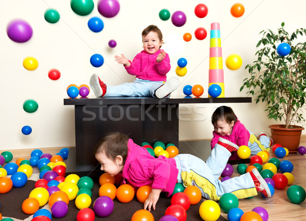 Fiatal lány gyermek szórakozás játszik színes műanyag Stock fotó © leventegyori