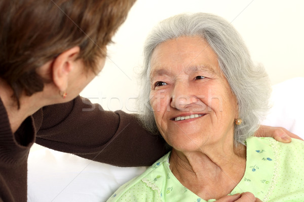 Careing for a elderly woman lying in bed Stock photo © leventegyori
