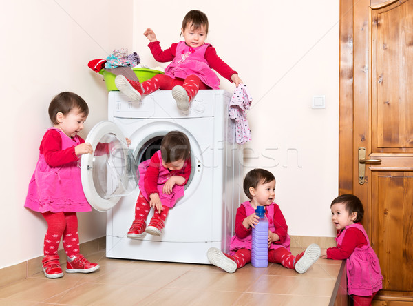 Happy actuve little child using washing machine at bathe Stock photo © leventegyori
