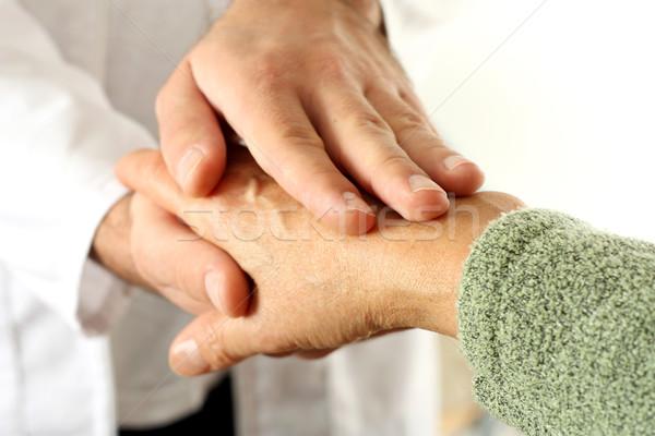 Holding patient hand Stock photo © leventegyori