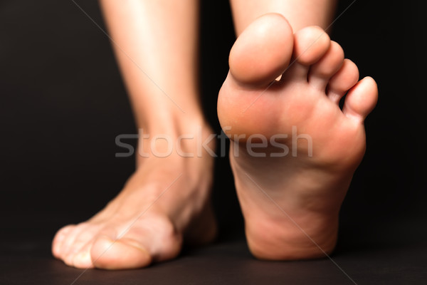 Foot stapping isolated on black Stock photo © leventegyori