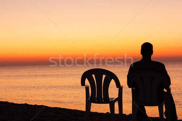 Man sits on chair alone in sunset Stock photo © leventegyori