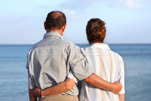 Romantic happy senior couple on a tropical beach Stock photo © leventegyori
