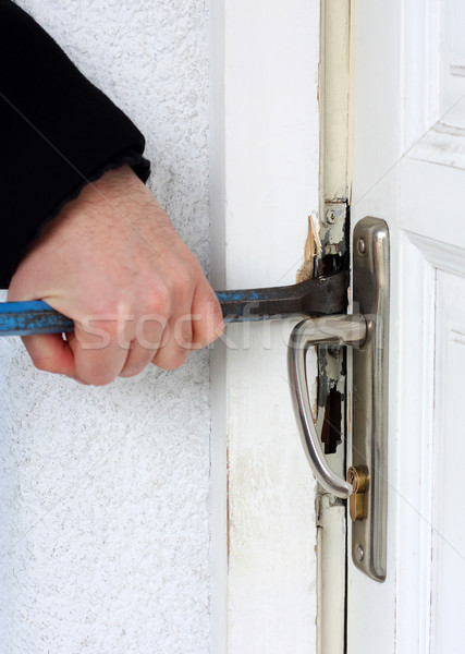 Thief breaking into a house Stock photo © leventegyori