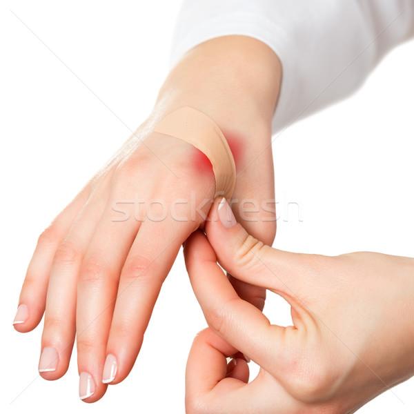 Putting plaster on hurt red skin Stock photo © leventegyori