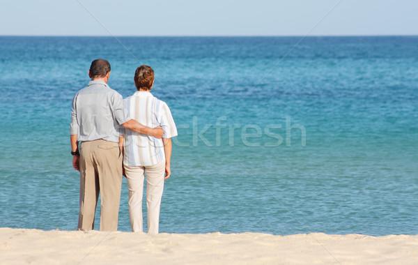 Romantic happy senior couple on the beach Stock photo © leventegyori