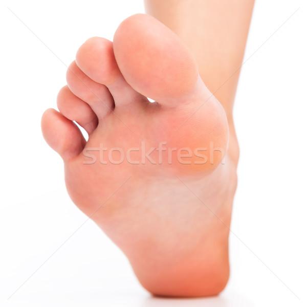 Foot stepping on white Stock photo © leventegyori