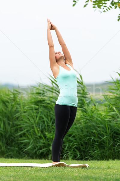 Femme yoga côté lune croissant Photo stock © leventegyori