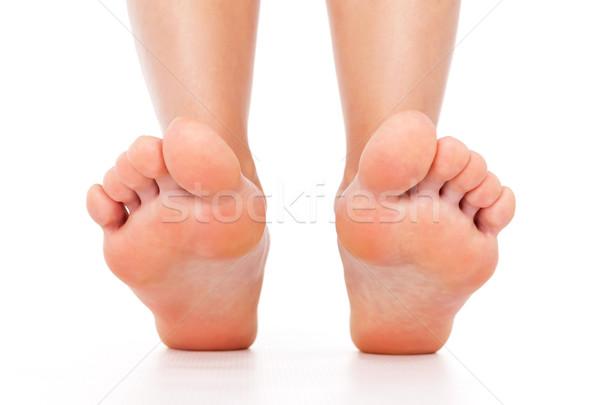 Foot stepping legs isolated Stock photo © leventegyori